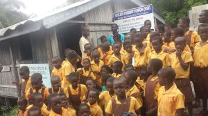 Some students and staff of Nzulezo District Assembly Primary School gathered on the school compound