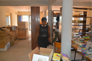 Canadian student volunteers sorting books